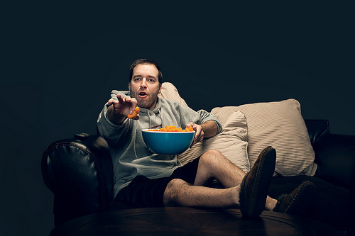 image of unhealthy man on couch