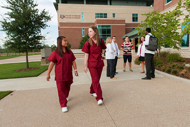Nursing students outside education building.