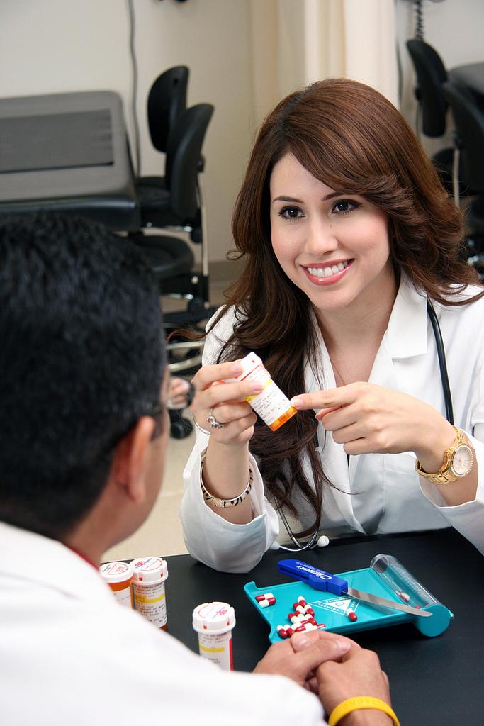 A pharmacist explaining a prescription to an associate.