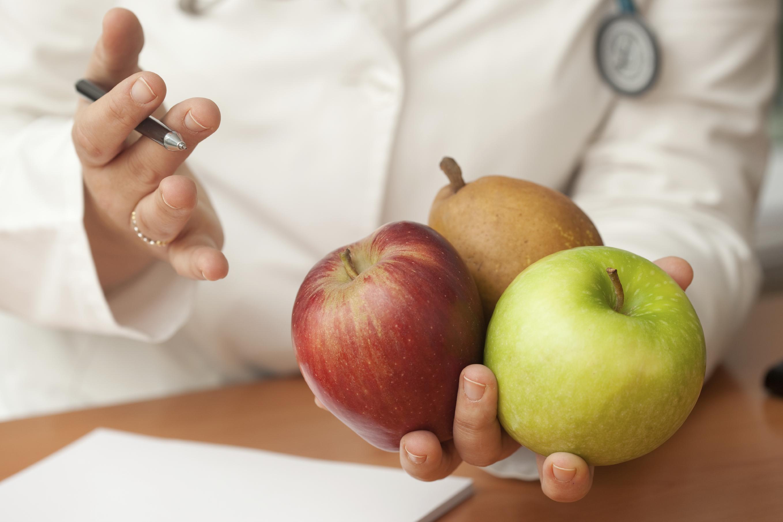 health professional teaches healthy nutrition