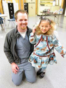 Dr. Jonathan Oudin '11 with one pediatric patient