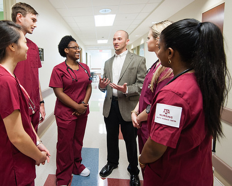 Dr. Gosselin talking to nursing students in the hall of the Clinical Learning Resource Center.