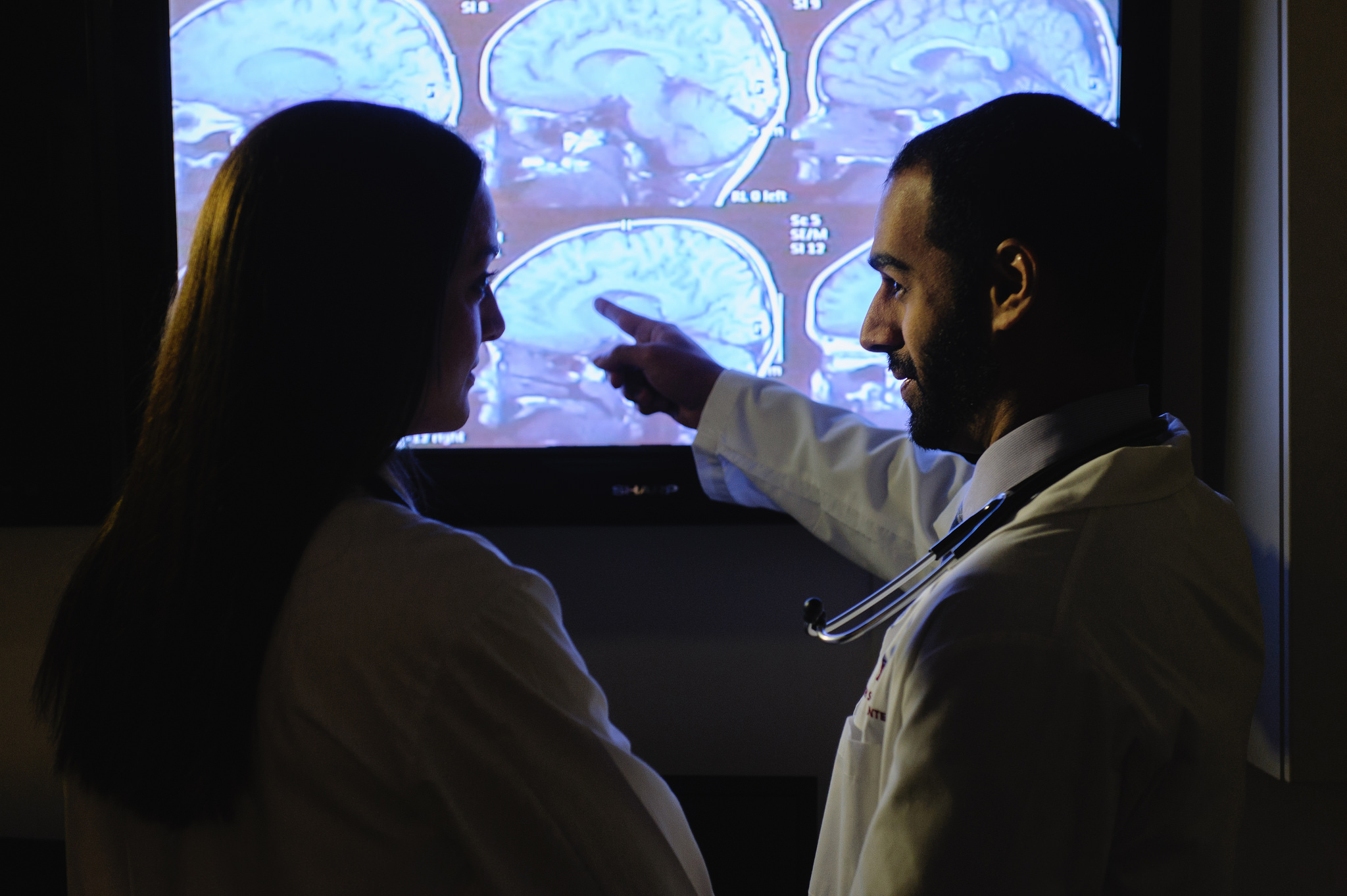 photo of physician and patient looking at brain image