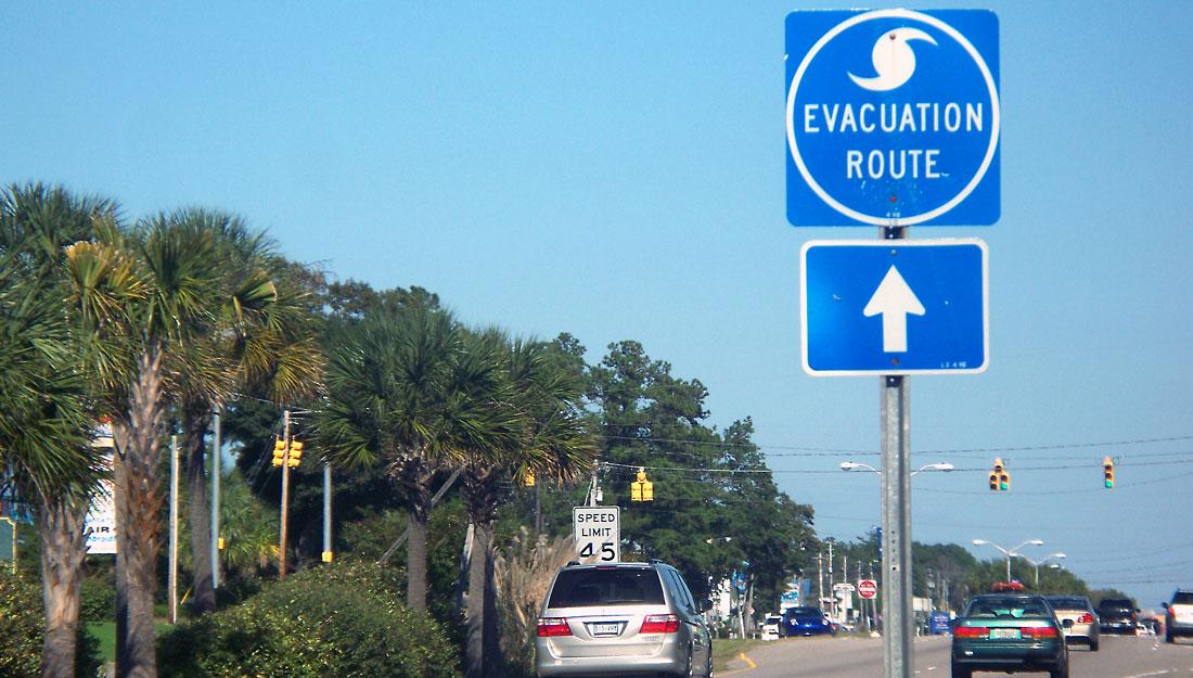 Hurricane Evacuation sign with traffic