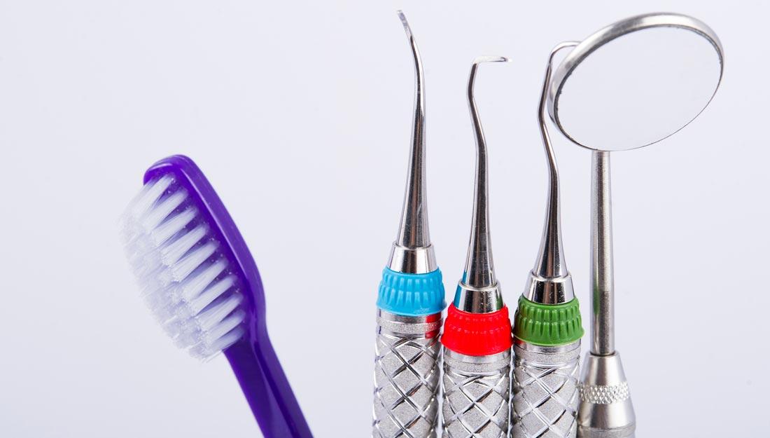 A glass full of dental tools.