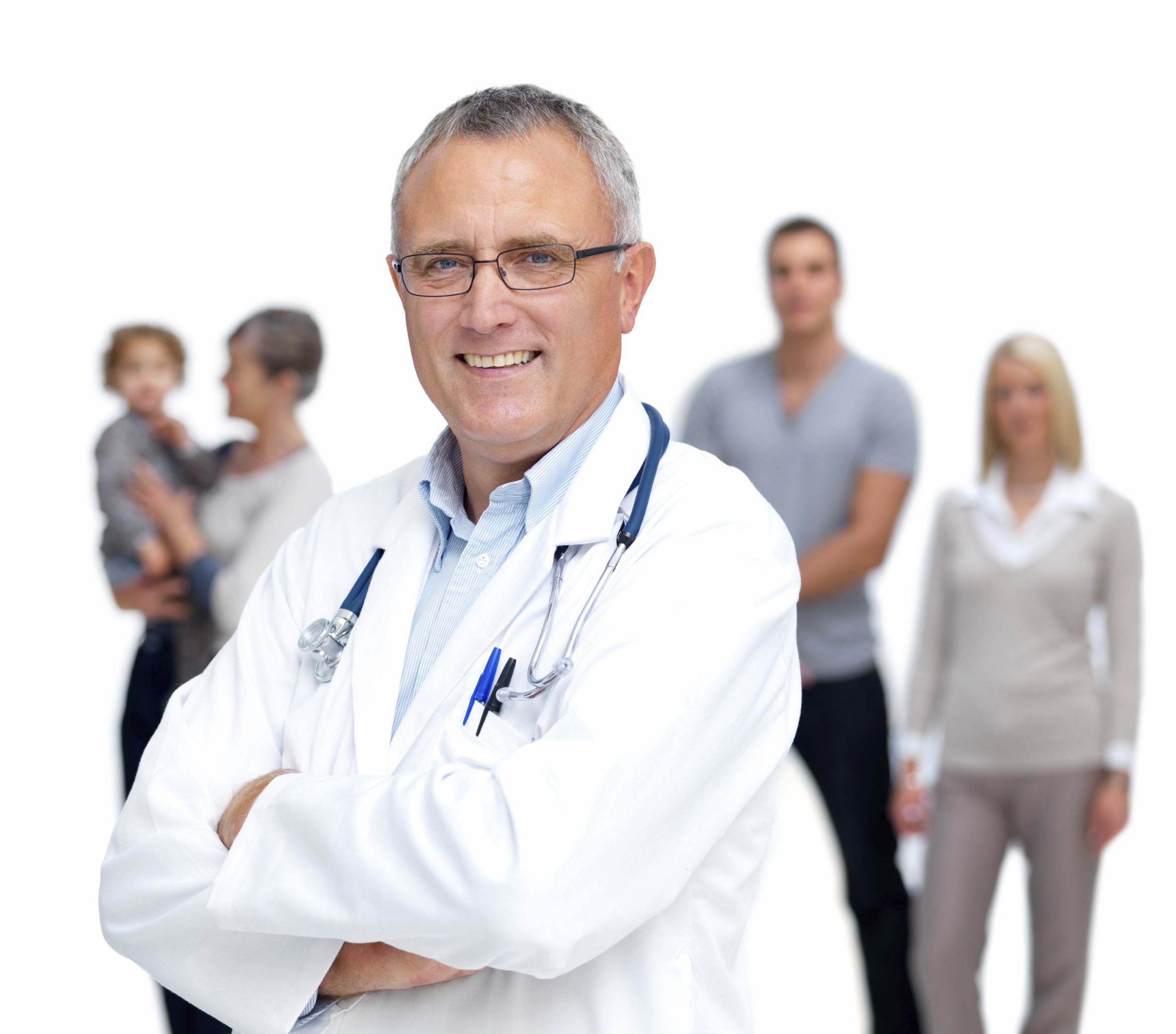 Physician in the front with a family out of focus in the background.