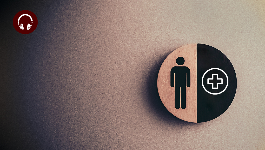Men's health awareness - A picture of a bathroom sign on a wall with a figure of a man on the left and a plus sign on the right