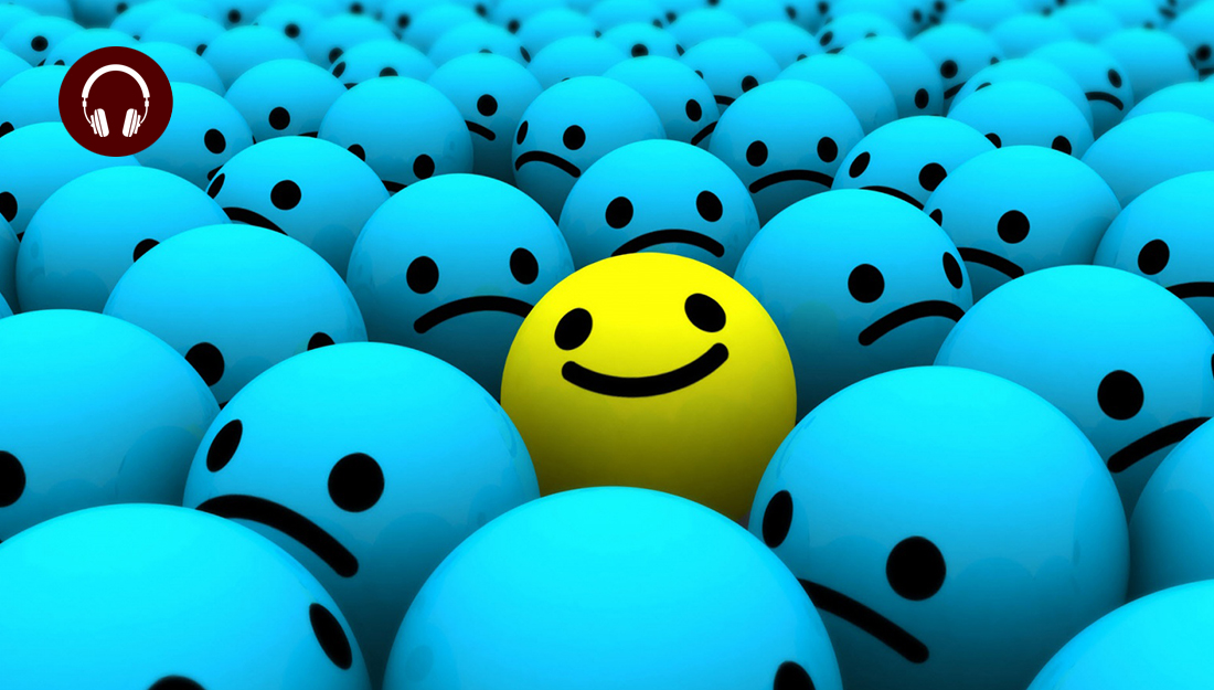 The happiness equation - a yellow smiley face in a sea of blue frowns