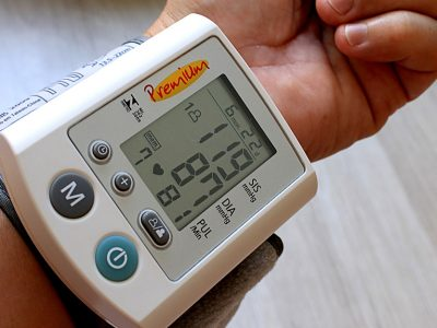High blood pressure-a blood pressure monitor on a person's wrist