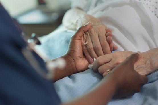 nurse comforting older patient
