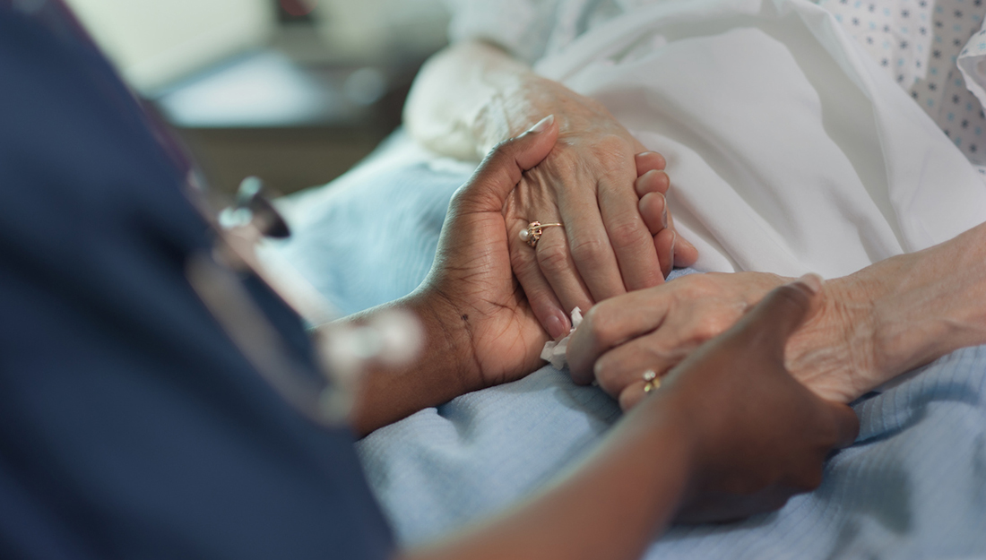 nurse comforting older patient