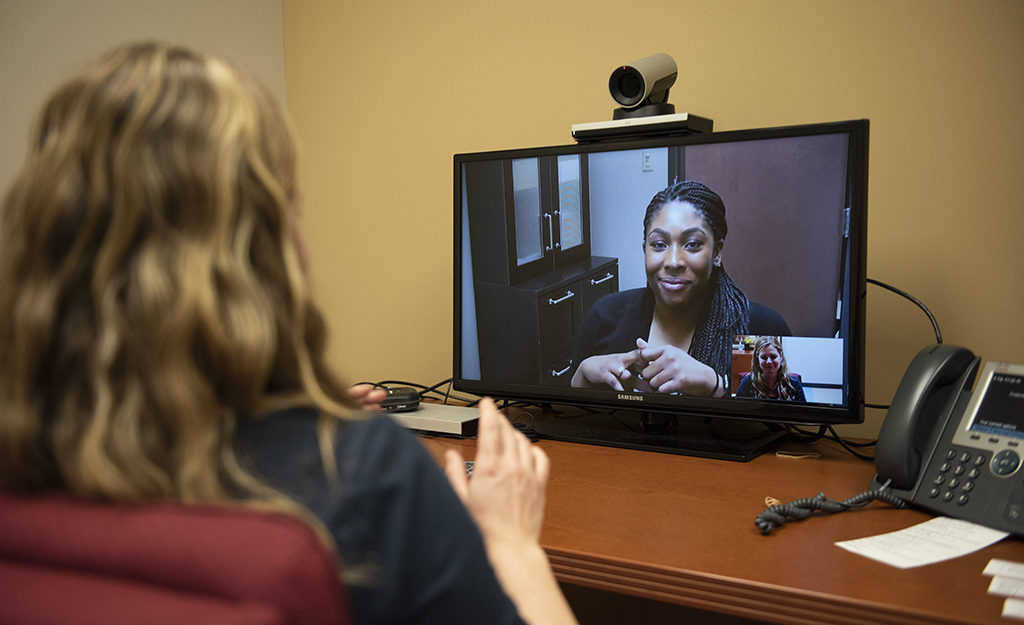 COVID-19_Telehealth_Telebehavioral care_Telemedicine_A woman speaks to another woman over the hipaa-approved software
