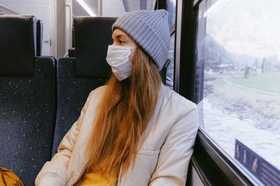woman wearing a medical mask on a train