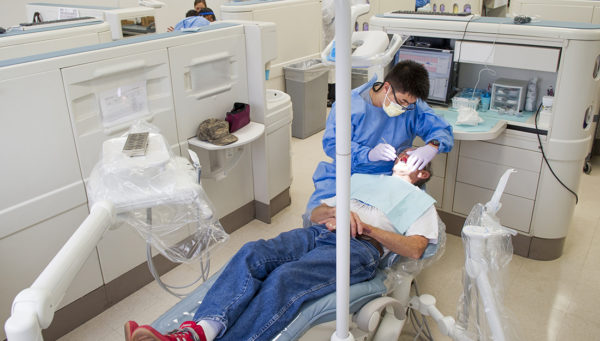 dentist-working-with-patient-in-clinic