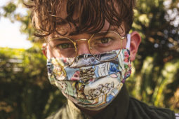 A man wears a cloth face mask outside