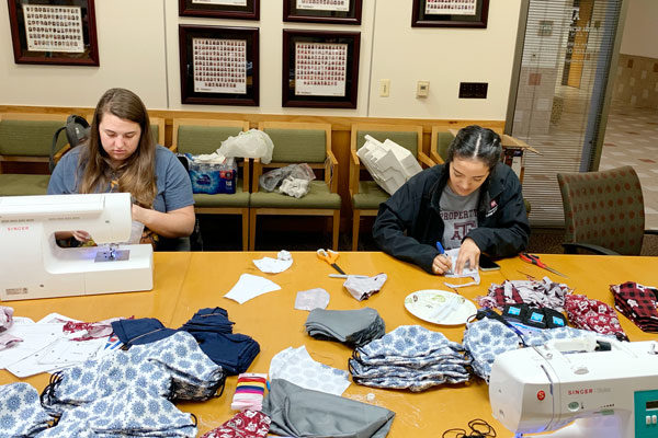 two Texas A&M pharmacy students sew face masks