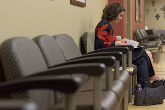woman sitting in clinic waiting room