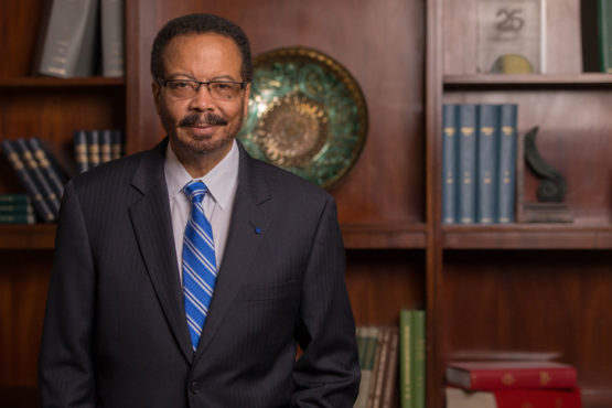 portrait of Roderic Pettigrew standing in his office