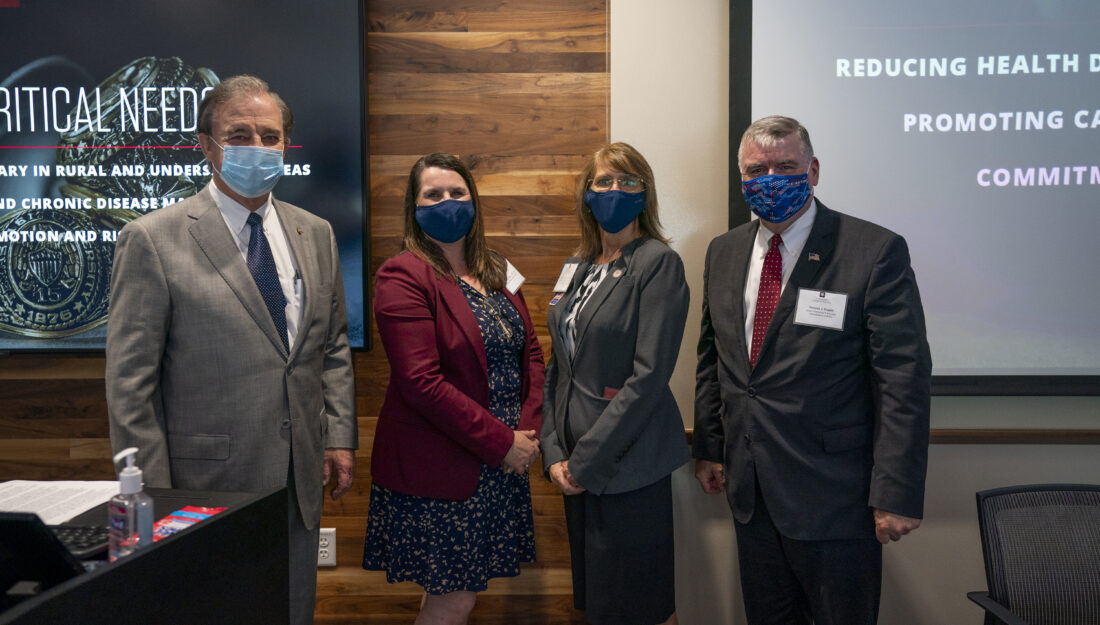 Photo of Chancellor John Sharp, Dr. Jodie Gary, Dr. Nancy Downing and HRSA Administrator Thomas J. Engels standing together with face masks on