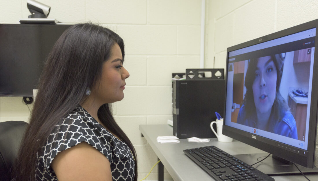 woman talks to counselor over video chat