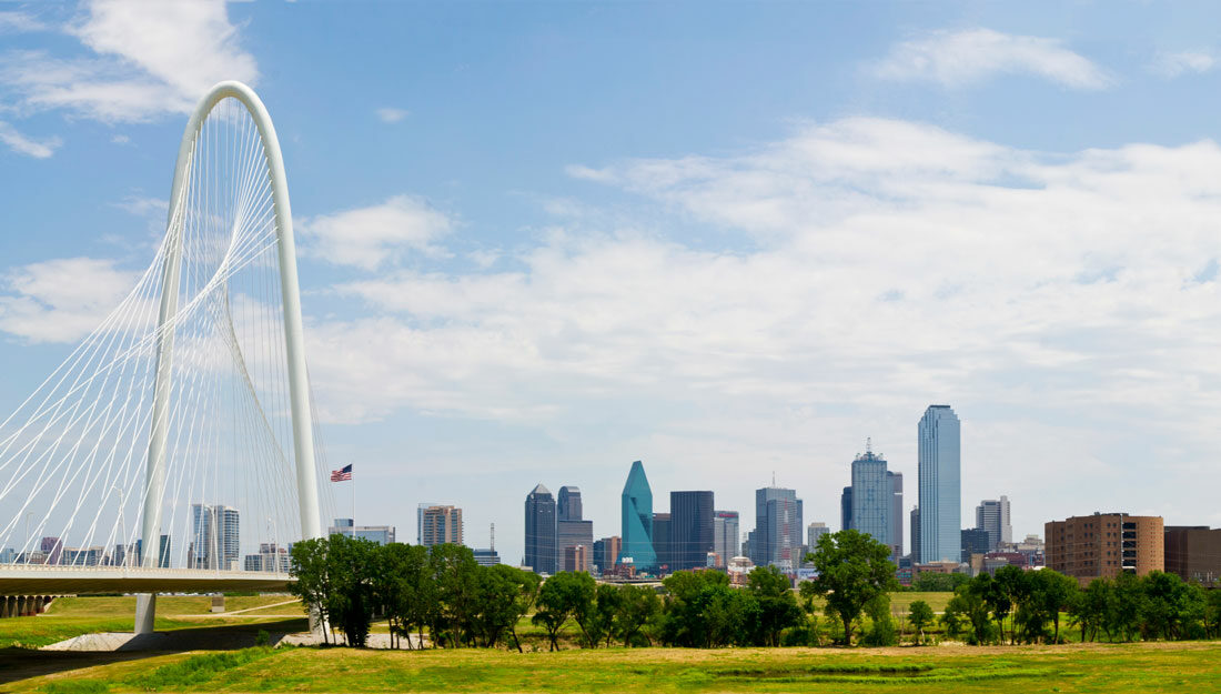 view of Margaret Hunt Hill Bridge leading to metropolitan Dallas, Texas