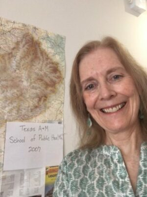 photo of Martha Conkling in front of a map of Africa
