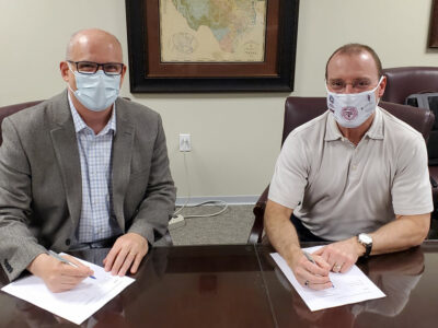 Jon Mogford, Texas A&M System Vice Chancellor for Research, and Andrew Arrage, Chief Commercial Officer for Matica Bio, sign master research agreement
