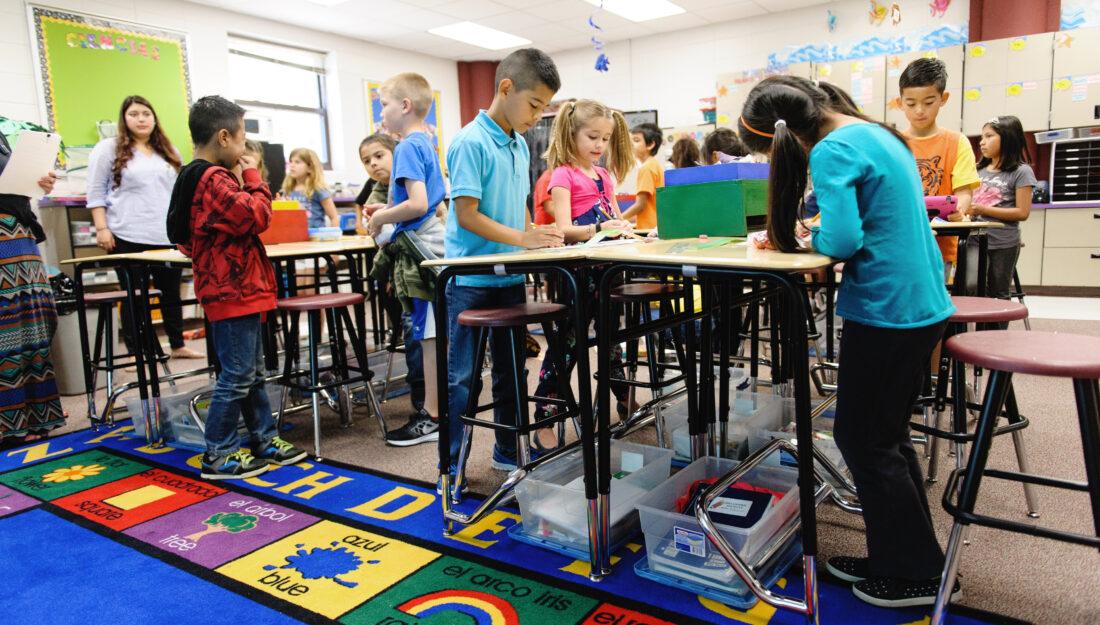 elementary school children work in a classroom