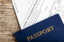 passport and COVID-19 vaccination record card